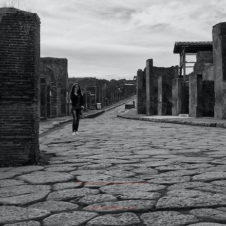 Street photography in Pompeii - mono - Can you spot the other person?