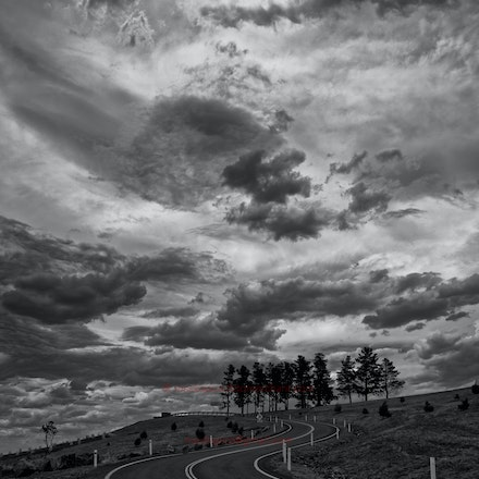 Threatening skies over Dairy Farmers Hill - At the National Arboretum of Australia, Canberra