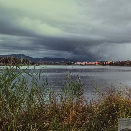 Approaching storm over Tuggeranong - A summer storm gathers in the Brindabella Range south of Tuggeranong, ACT. This is a 35mm film-based image composed...