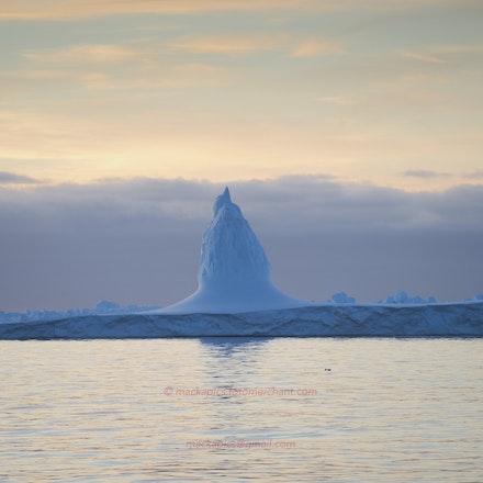 An ethereal iceberg at dusk