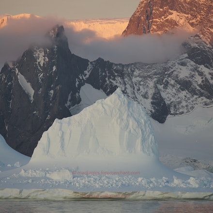 Fallières Coast at dusk - This was taken sailing out of the northern end of Marguerite Bay on the Fallières Coast of the Antarctic Peninsula.