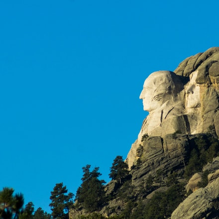 DSC05966 - George Washington and Thomas Jefferson look to the sunrise at Mount Rushmore, South Dakota.