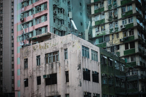 Slow Victory - In HongKong, there is a whole range of new to old, clean to rundown. Each apartment building has its own pastel pinks, greens or blues....