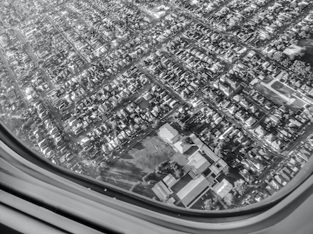 One Window Many Lives - A steep turn to the runway. Looking nearly straight down. Gulp.