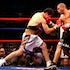 WBA World Welterweight Championship Alfonso Gomez vs Miguel Cotto - In action during the WBA World Welterweight Championship Miguel Cotto  (Trunks: Black...