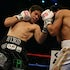 Tom Briglia Photographer #230 - Alfonso Gomez (Black Trunks) hits Arturo Gatti (White Trunks) and drives him back  in action during their schedule 10 Round...