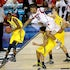 Over the top - Chane Behanan (21) of the Louisville Cardinals lands on top of Glenn Robinson III (1) of the Michigan Wolverines for a foul in the second...