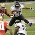 Leaping Raven - Running back Ray Rice (27) of the Baltimore Ravens leaps over a teammate in the first half of Super Bowl XLVII at the Mercedes-Benz Superdome...