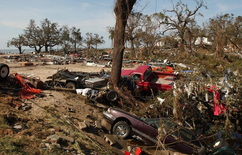 Biloxi flattened - Mangled vehicles lie among piles of debris from homes and other buildings at the intersection of Porter Avenue and US 90 in Biloxi,...