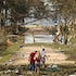 Ocean Springs devastation - Residents of Ocean Springs pick their way through a debris-filled street the day after Hurricane Katrina devastated the Mississippi...