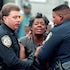 Consoling cops - Police officers in Jackson, TN, console a woman at the scene of a fatal shooting.