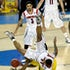 Upended - Chane Behanan (21) of the Louisville Cardinals lands on top of Glenn Robinson III (1) of the Michigan Wolverines for a foul in the second half...