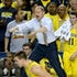 Michigan-Syracuse - Head coach John Beilein of the Michigan Wolverines yells instructions to his team  in the first half in an NCAA Final Four semifinal...