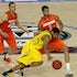 Dribble drive - A player for the Michigan Wolverines drives against a Syracuse Orange defender in the second half in an NCAA Final Four semifinal at the...