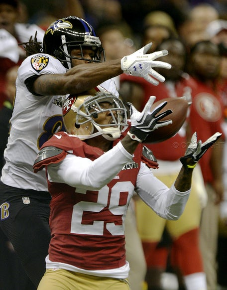 Interception - Chris Culliver (29) of the San Francisco 49ers tries to intercept a ball intended for Anquan Boldin (81) of the Baltimore Ravens in the...