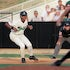 Jumping the pitch - A player for the Jackson, TN, Diamond Jaxx double A baseball team takes a big lead off first base during a pitch in a game against...