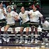 Jump for joy - Players on a girls basketball team celebrate their last-second win of the state high school championship game.