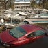 Biloxi devastation - A car lies in a swimming pool at what was once a condominium complex on US 90 in Biloxi, MS, the day after Hurricane Katrina devastated...