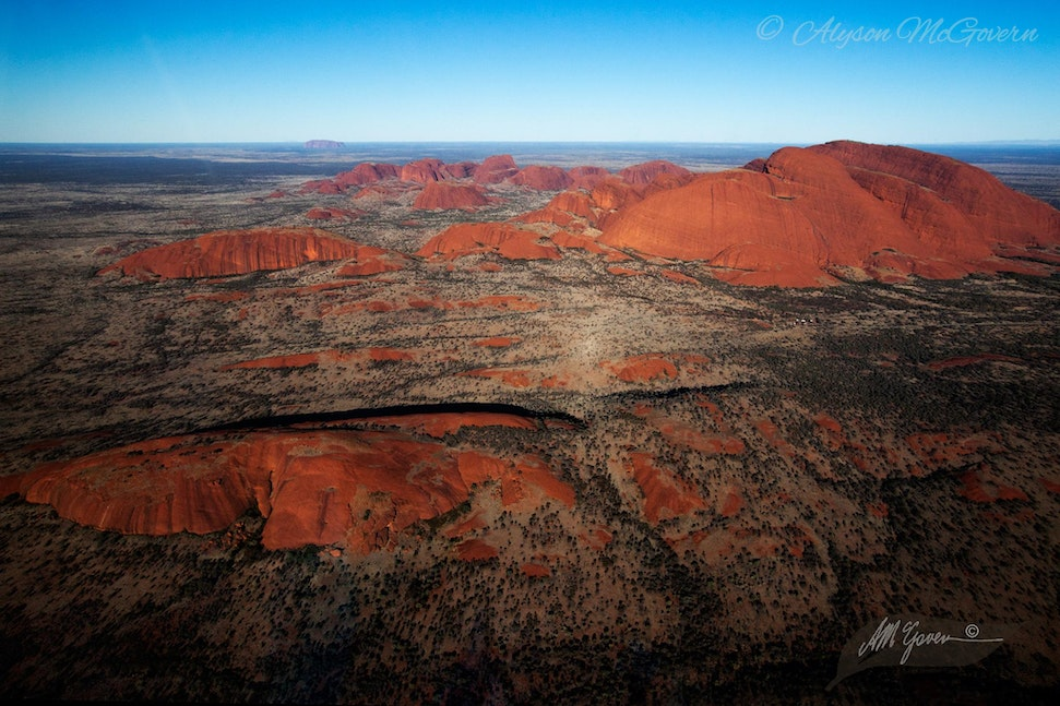 Kata Tjuta Aerial NT_9691 - Aerial View looking over Kata Tjuta (The Olgas). Uluru, a fifty km drive from Kata Tjuta, can be seen in the distance, Northern...