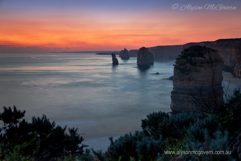 Sunsets over the Apostles VIC_0456 - The 12 Apostles were created by constant erosion of the limestone cliffs of the mainland beginning 10-20 million years...