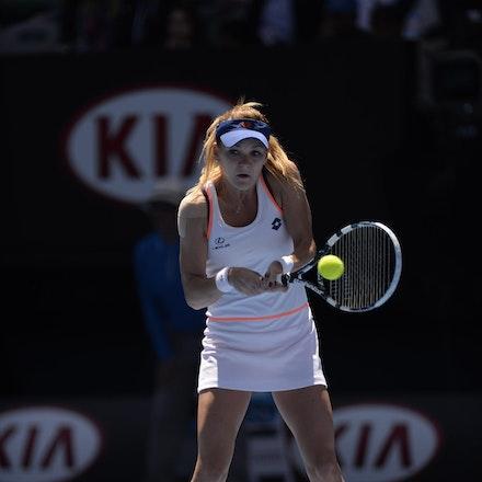 Blakeman_2014_104637 - Agnieszka RADWANSKA (POL) defeats Victoria AZARENKA (BLR) 6-1, 5-7, 6-0 on day 10 at Rod Laver Arena