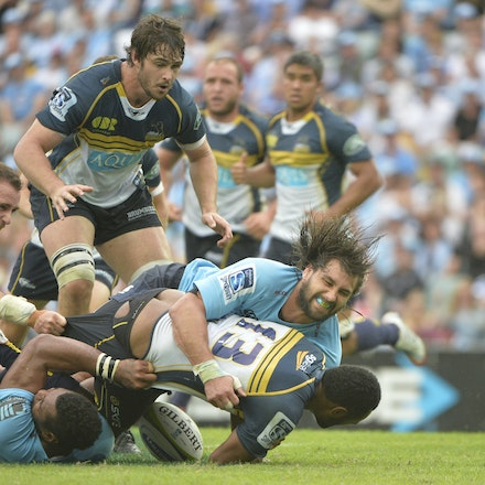 _PB17134 - 2015 22nd March. Waratahs defeat the Brumbies at Allianz Stadium 28-13, Left Flanker Jacques Potgieter tackles Outside centre Tevita Kuridrani