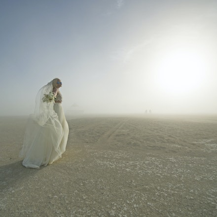 _PB17925 - Craig and Louise get married at Burning Man in in the Nevada Desert. During the wedding a dust storm came through, said to be one of the worst...