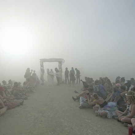_PB17967 - Craig and Louise get married at Burning Man in in the Nevada Desert. During the wedding a dust storm came through, said to be one of the worst...