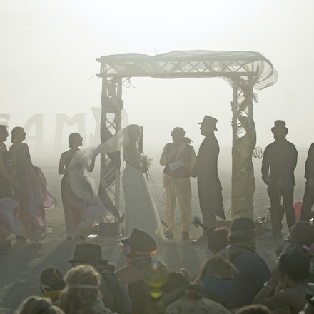 _PB17991 - Craig and Louise get married at Burning Man in in the Nevada Desert. During the wedding a dust storm came through, said to be one of the worst...