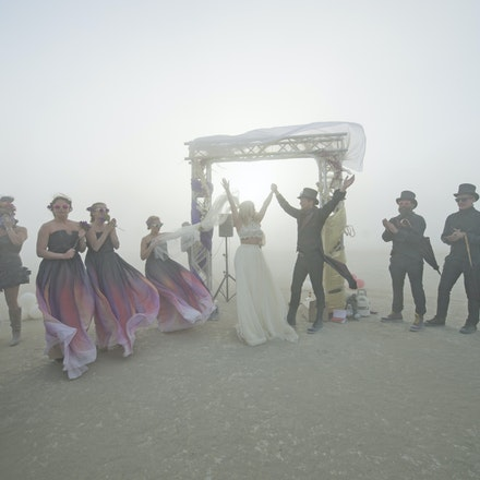 _PB18078 - Craig and Louise get married at Burning Man in in the Nevada Desert. During the wedding a dust storm came through, said to be one of the worst...