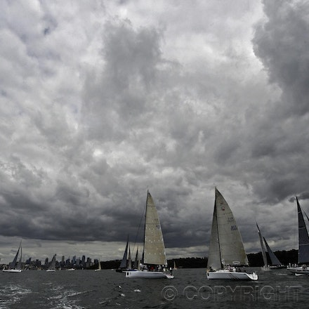 _DSC0814 - 17.12.2011. Sydney, Australia. Day 3. Rolex Trophy Passage Series.A general shot of the fleet as a storm passes leaving smooth sailing for the...