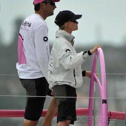 _DSC3461 - 26.12.2011. Sydney, Australia. Rolex Sydney to Hobart Yacht Race 2011. Jessica Watson at the helm on her boat, Ella Bache.