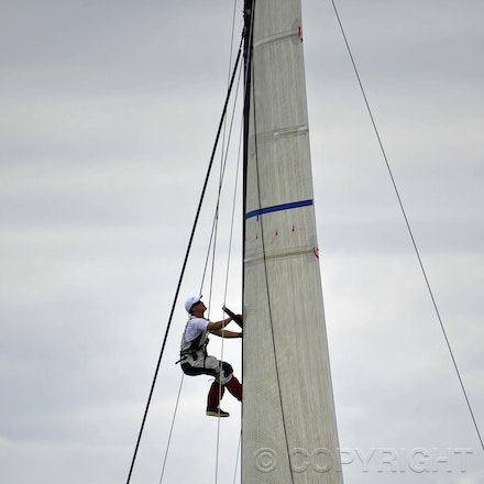 _DSC3505 - 26.12.2011. Sydney, Australia. Rolex Sydney to Hobart Yacht Race 2011. A crew member from Shogun climbs the mast for last minute adjustments...