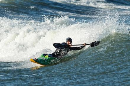 140413_surfkayaking_6113 - JBK instructor Tracy Gibson surf kayaking at Huskisson (Jervis Bay), NSW (Australia) on April 13 2014. Photo: Jan Vokaty