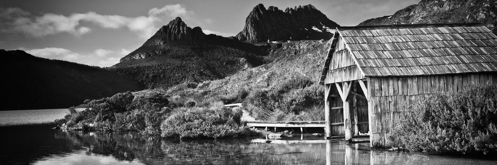 Dove Lake Boatshed - This photograph was captured after a rare clear sunrise at Dove Lake which sits at the base of Cradle Mountain in Tasmania. Just previously,...