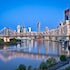 Dawn City - Brisbane - In June 2011, an early morning lunar eclipse occurred, timely enough for the moon-set on dawn. The eerie red light illuminated the...