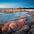 Red Granite - Friendly Beaches, Freycinet - The rocks at Friendly Beaches on the East Coast and the stunning white sand, deliver a calmness that is reminiscent...