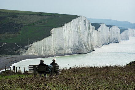 The Seven Sisters, _IGP3136 - Two people enjoy the view of the the Seven Sisters cliffs in Sussex England