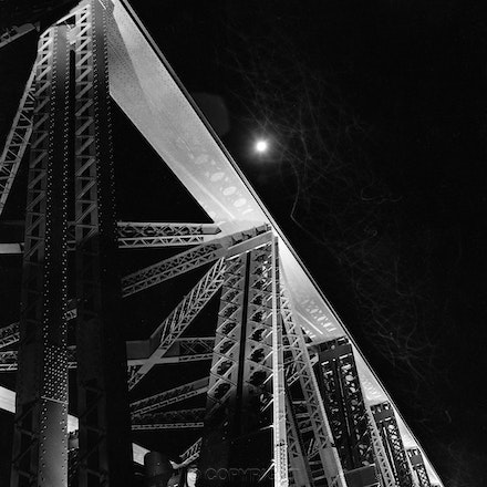 The Sydney Harbour Bridge structures  pylons, Moon and fireflies . - Long exposure on tripod mounted Hasselblad camera .  Each archival photograph is stamped...