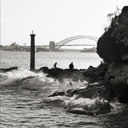 Bradleys Head and Surf and fishermen looking towards The Opera House. - Each archival photograph is stamped and signed by Robert and a brief description...