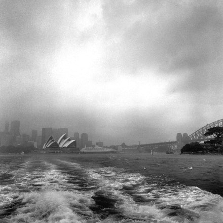 Mosman Ferry Wake & QE2 - The QE2 is about to leave Circular Quay.   Each archival photograph is stamped and signed by Robert and a brief description of...