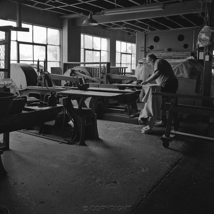 Tanning Factory Worker - Each archival photograph is stamped and signed by Robert and a brief description of how it was taken.
