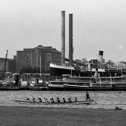 White Bay Balmain and Chinese Racing/rowing boat. - Photographed from Glebe Park looking towards Rozelle,2005.   Each archival photograph is stamped and...