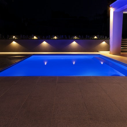 Pool cover installation - Evening shoot of a newly installed pool and pool cover - commercial client.
