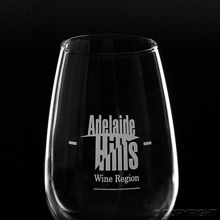 A Wine Glass - with logo - Utilising a black background with the wine glass shape enhanced through utilising the angle of incidence of reflected light.