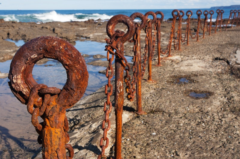 Rusty chains, Bogey hole, Newcastle - Rusty metal chain at the bogey hole, Newcastle