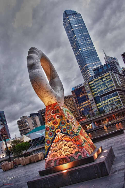 Rialto from Southbank in Melbourne - The Rialto tower in the background framed with one of the sculptures on the river bank of Southbank in Melbourne.