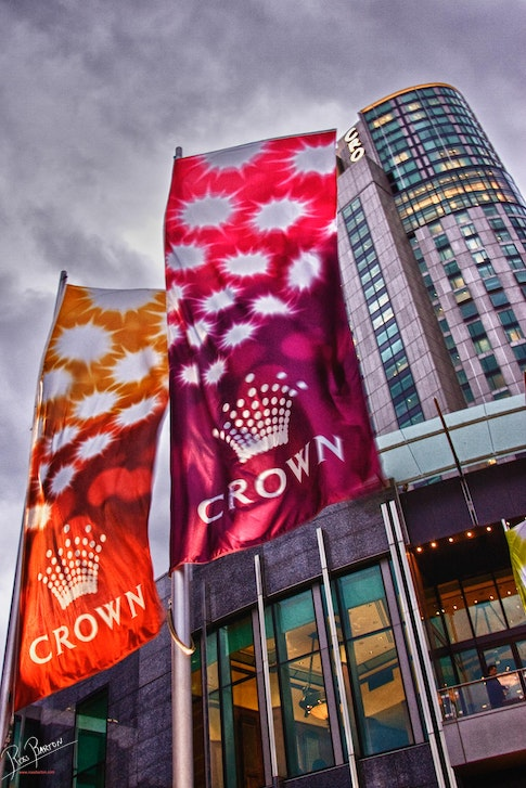 Crown Casino Tower on Southbank in Melbourne - Flags fly in the breeze in front of Crown Casino Tower on the South Bank of the Yarra River in Melbourne,...