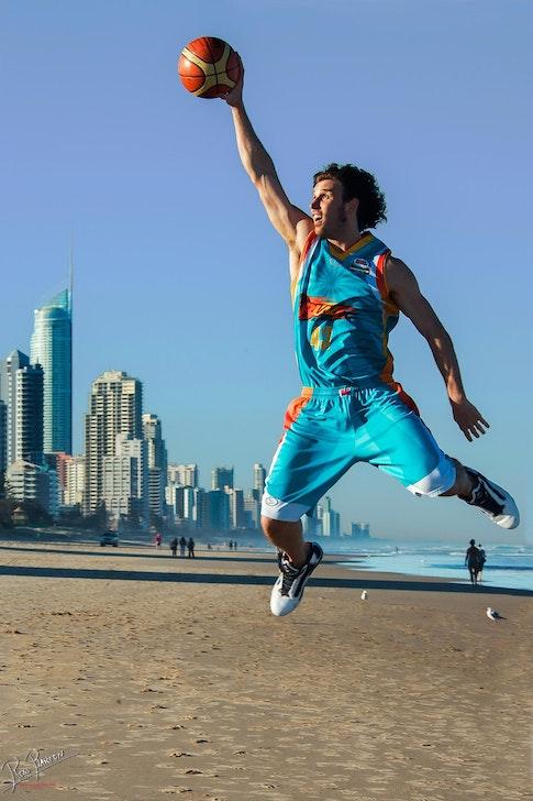 Zen_RB_071113_172329_1 - Casey Frank dunks on Q1 at Broadbeach during The Gold Coast Blaze team photoshoot.
