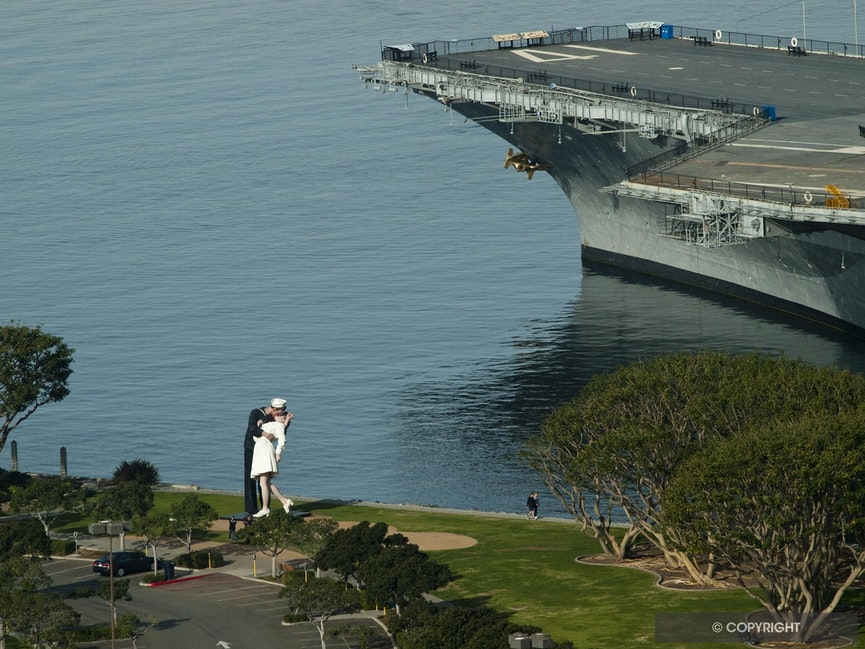 VJ Kiss - J. Seward Johnson's Unconditional Surrender statue of Eisenberg's 1945 VJ Kiss photo and carrier Midway bow, San Diego, California